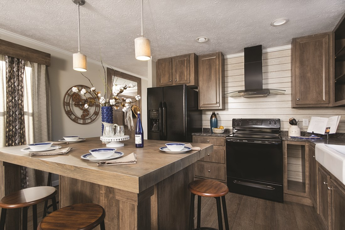 The THE PATRIOT HOME Kitchen. This Manufactured Mobile Home features 3 bedrooms and 2 baths.