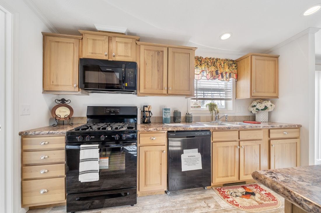 The FULTON 6028-2557D Kitchen. This Manufactured Mobile Home features 3 bedrooms and 2 baths.