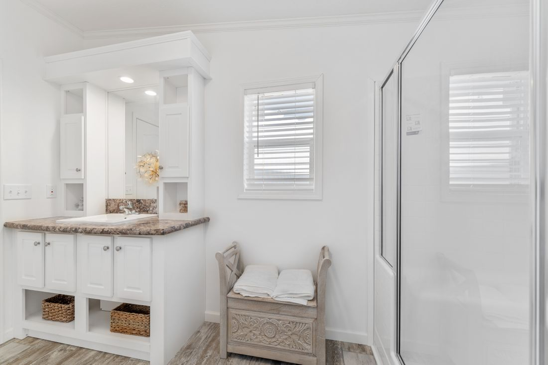 The FULTON 6028-2557D Master Bathroom. This Manufactured Mobile Home features 3 bedrooms and 2 baths.