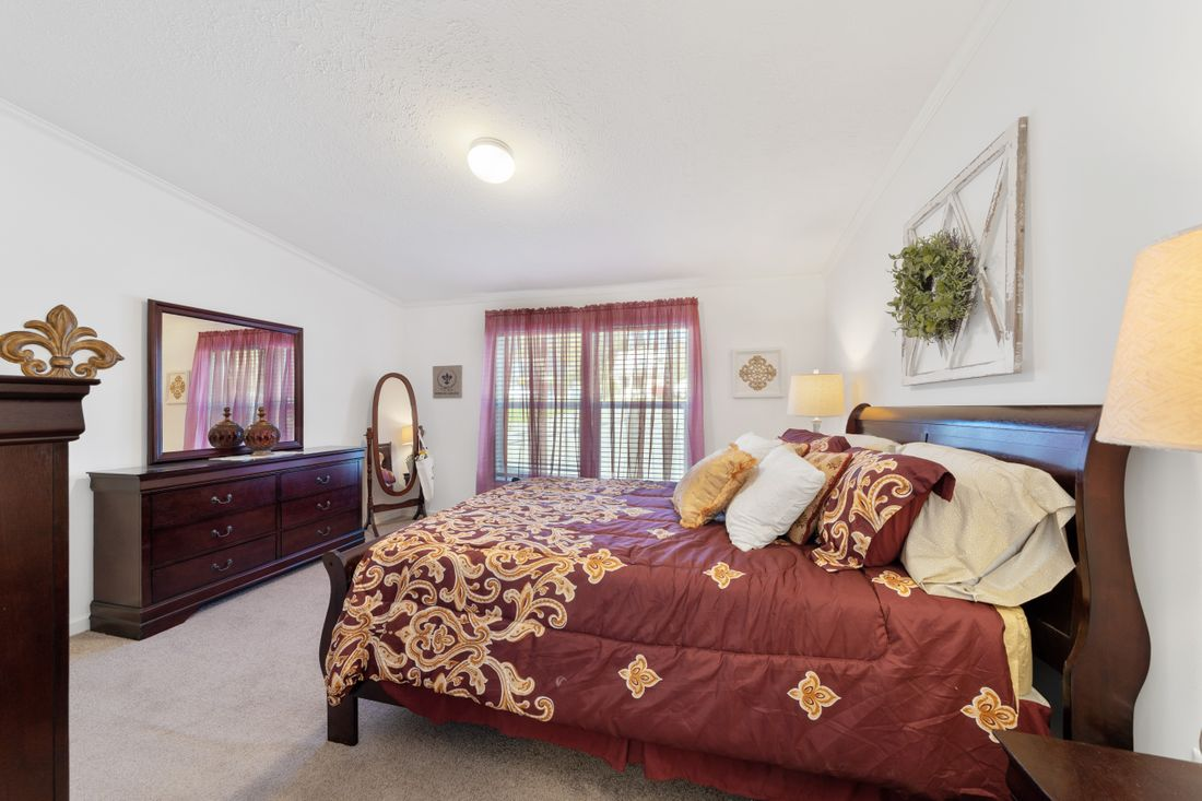 The FULTON 6028-2557D Master Bedroom. This Manufactured Mobile Home features 3 bedrooms and 2 baths.