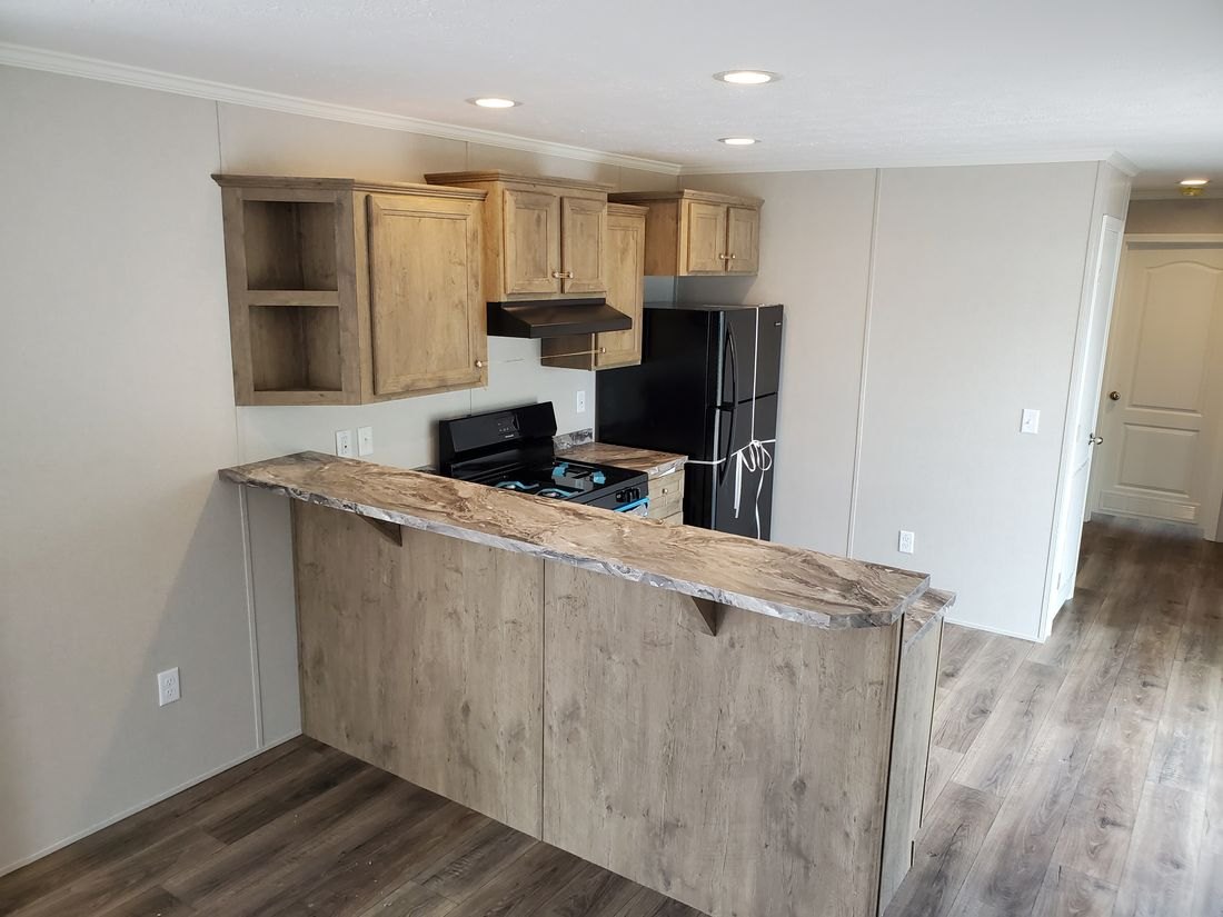 The BEECH 6414-60 Kitchen. This Manufactured Mobile Home features 3 bedrooms and 1 bath.