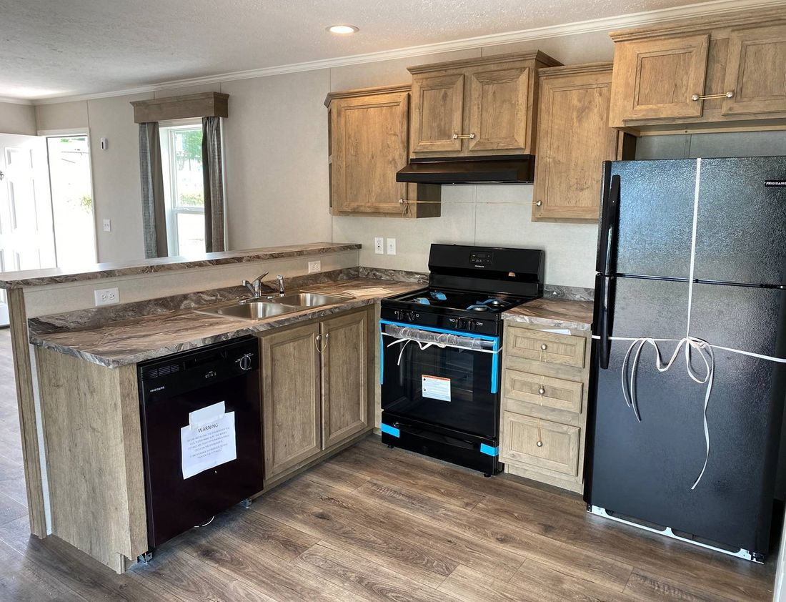 The HICKORY 4414-40 Kitchen. This Manufactured Mobile Home features 1 bedroom and 1 bath.