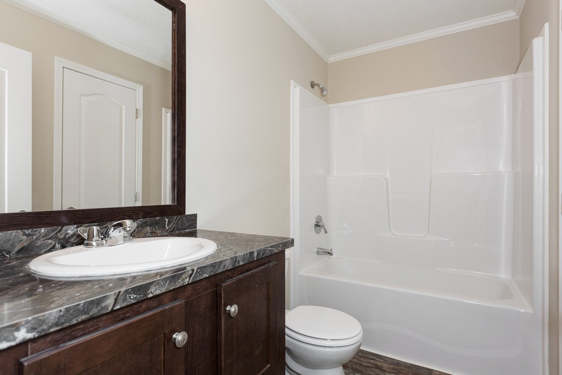 The HYDE PARK 5228-508-1 Guest Bathroom. This Manufactured Mobile Home features 3 bedrooms and 2 baths.