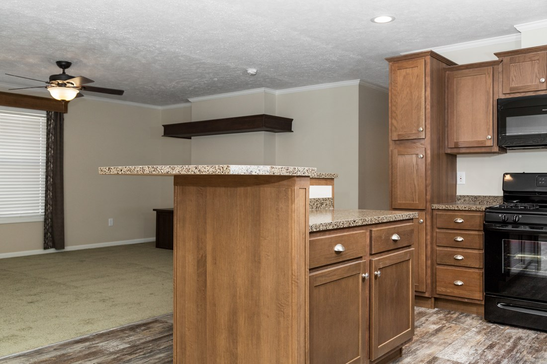 The HYDE PARK 5228-508-1 Kitchen. This Manufactured Mobile Home features 3 bedrooms and 2 baths.