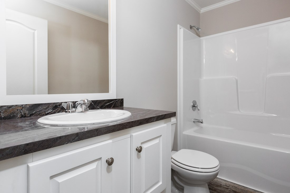 The ESPY 5628-2575A Guest Bathroom. This Manufactured Mobile Home features 3 bedrooms and 2 baths.