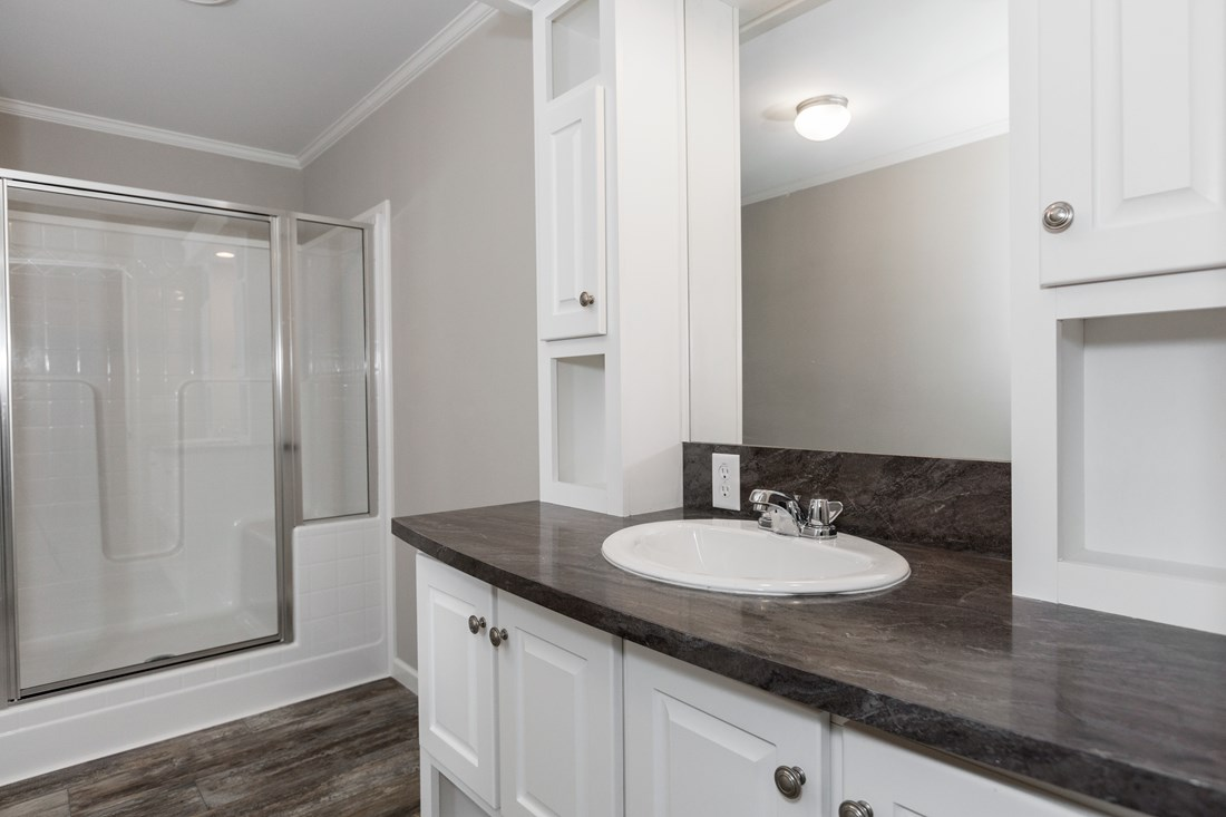 The ESPY 5628-2575A Master Bathroom. This Manufactured Mobile Home features 3 bedrooms and 2 baths.