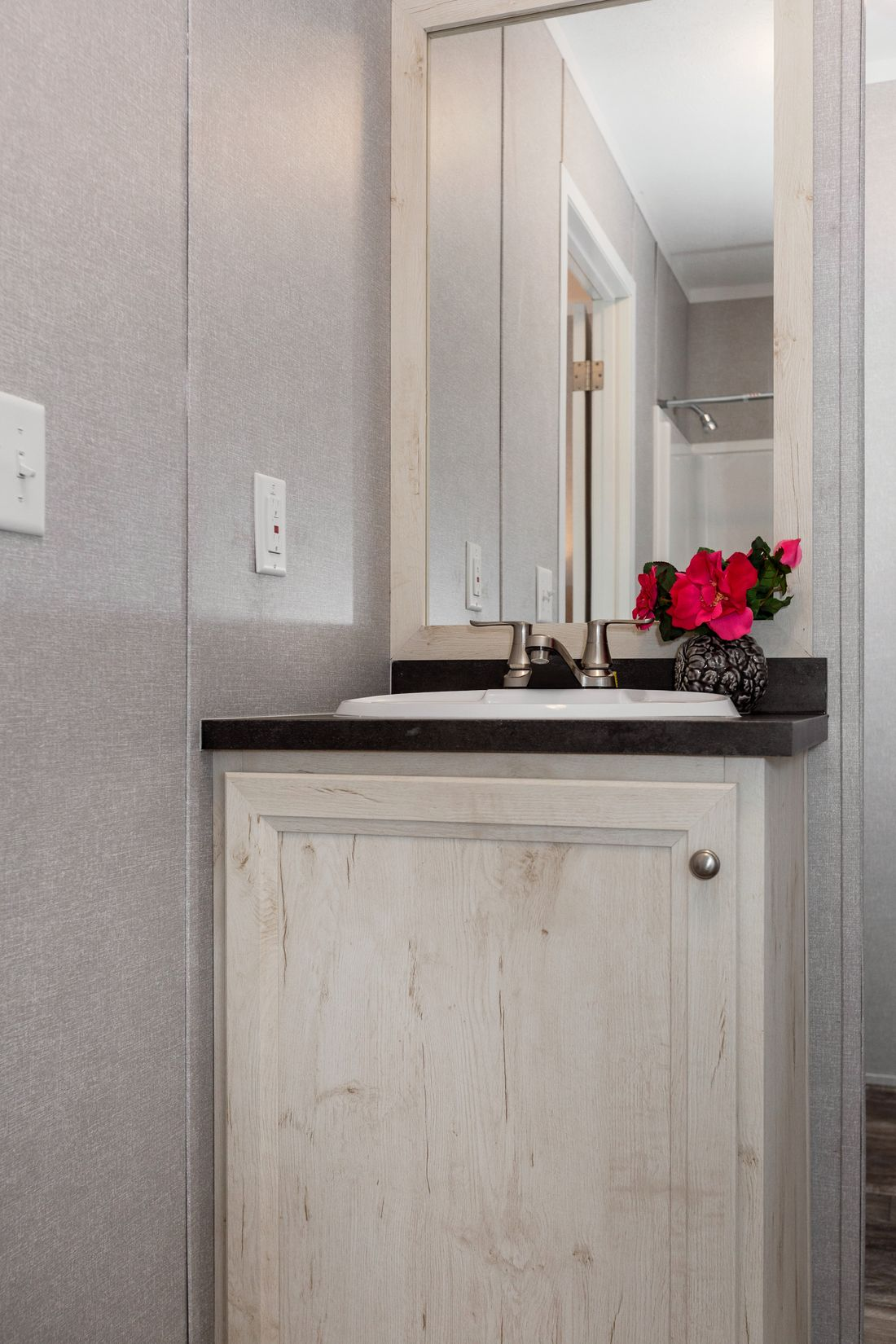 The SAPPHIRE Master Bathroom. This Manufactured Mobile Home features 3 bedrooms and 2 baths.