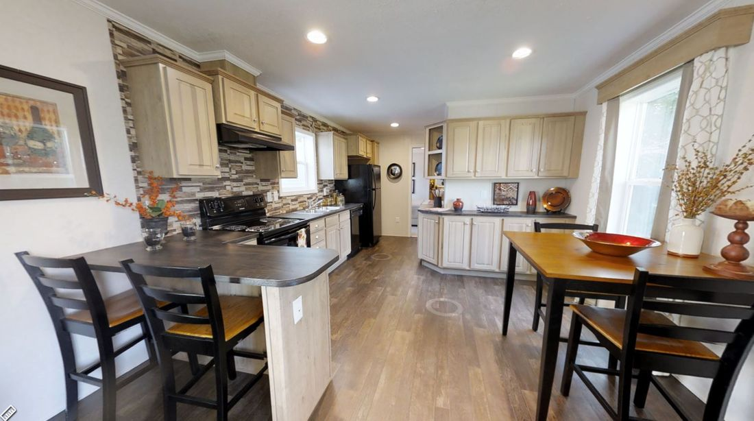 The LEXINGTON 7614-1792 Kitchen. This Manufactured Mobile Home features 3 bedrooms and 2 baths.