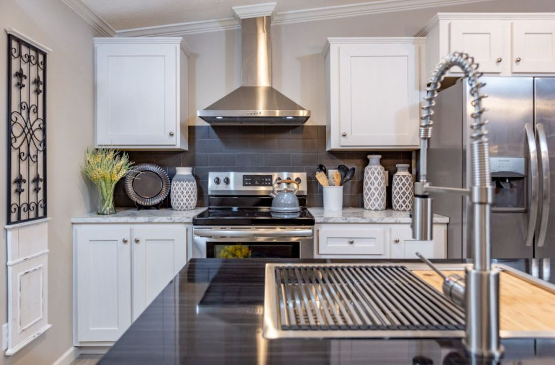 The HUDSON 6028-1680 Kitchen. This Manufactured Mobile Home features 3 bedrooms and 2 baths.