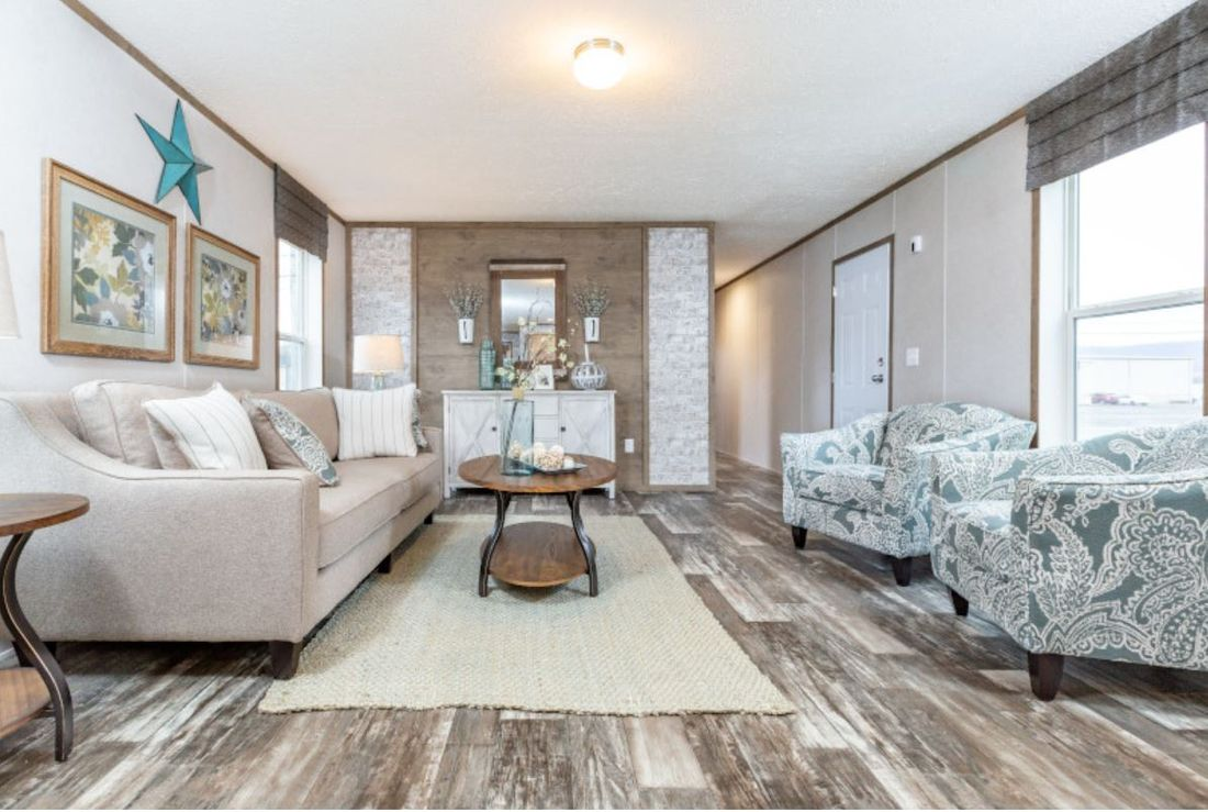 The DIAMOND Living Room. This Manufactured Mobile Home features 3 bedrooms and 2 baths.